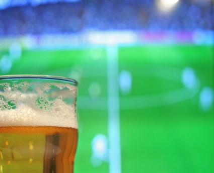 Beer-in-foreground-football-